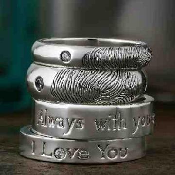 Custom personalised Fingerprint wedding rings.  Diamond set.